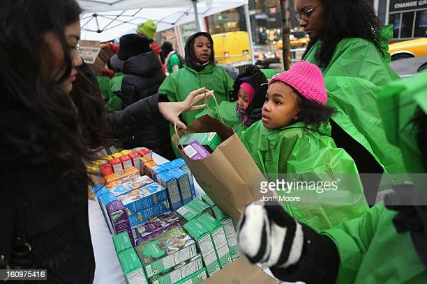 Girl Scouts sell cookies as a winter storm moves in on February 8, 2013 in New York City. The scouts did brisk business, setting up shop in locations...