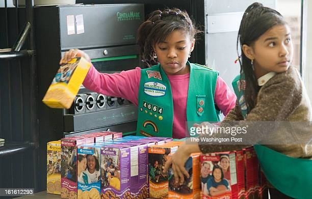 Girl scouts sell cookies at Freeman's Barber Shop in Upper Marlboro MD Lalah Williams left of Upper Marlboro MD is helping sell the cookies but has...