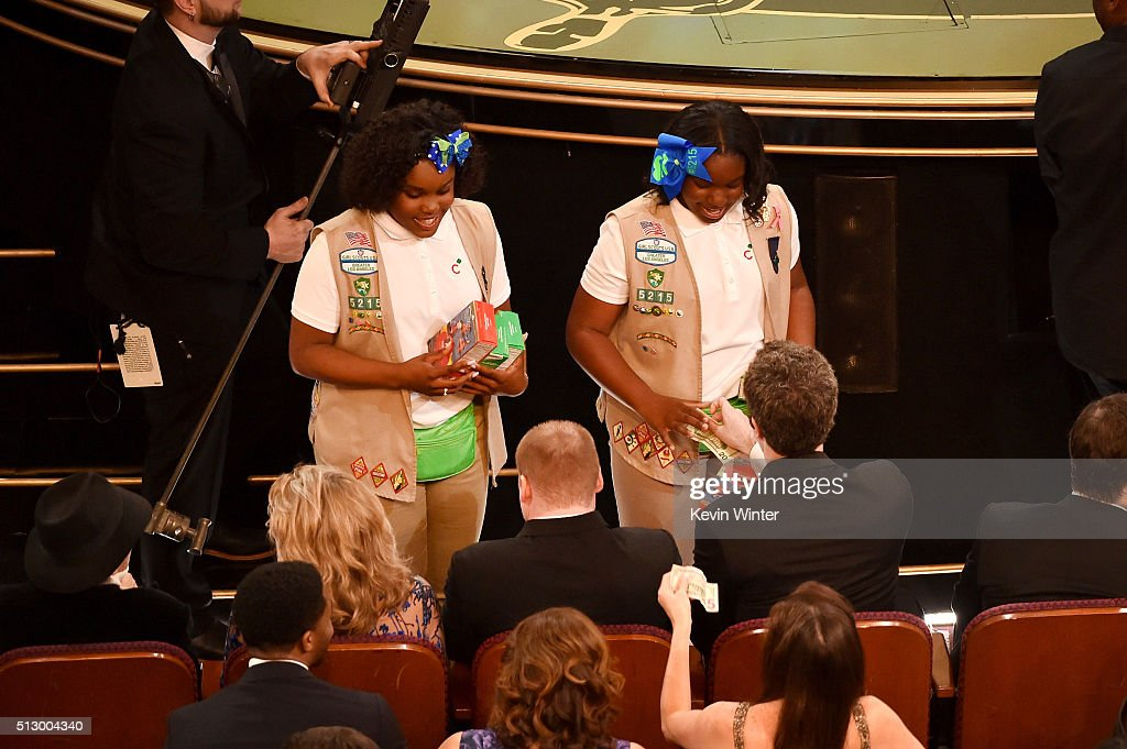 Girl Scouts sell cookies to audience members during the 88th Annual Academy Awards at the Dolby Theatre on February 28, 2016 in Hollywood, California.