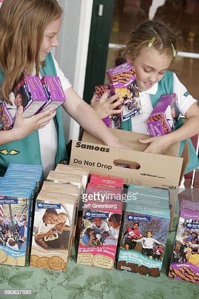 Girl Scouts Selling Girl Scout Cookies