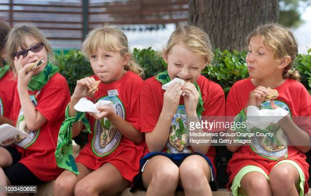 Girl Scouts take time out to celebrate National S'mores Day by eating the warm gooey creation sandwhiched between Girl Scout cookies They were at How...