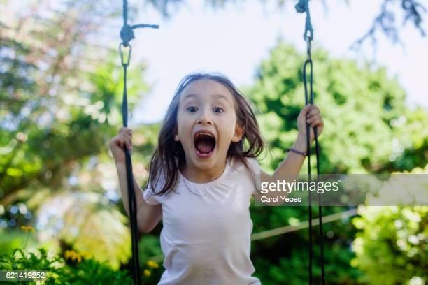 girl screaming in a swing
