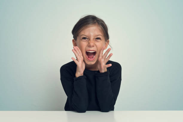girl screaming - loud girl stock pictures, royalty-free photos & images