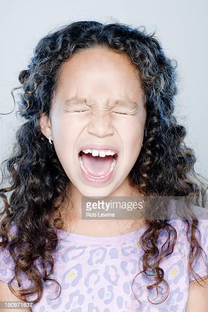 Girl (8-9) screaming, studio shot