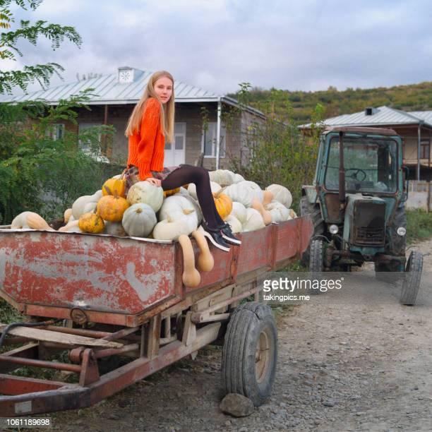 girl seat on pumpkin - コーカサス ストックフォトと画像