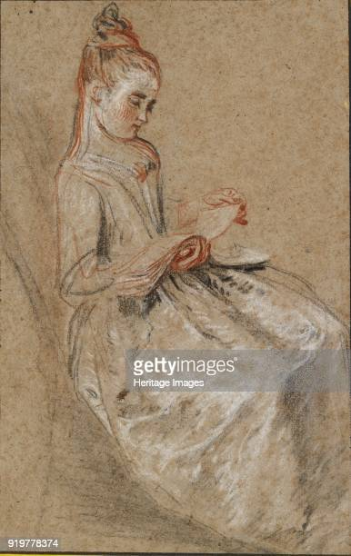 Girl seated with a Book of Music on her Lap early 18th century Artist JeanAntoine Watteau