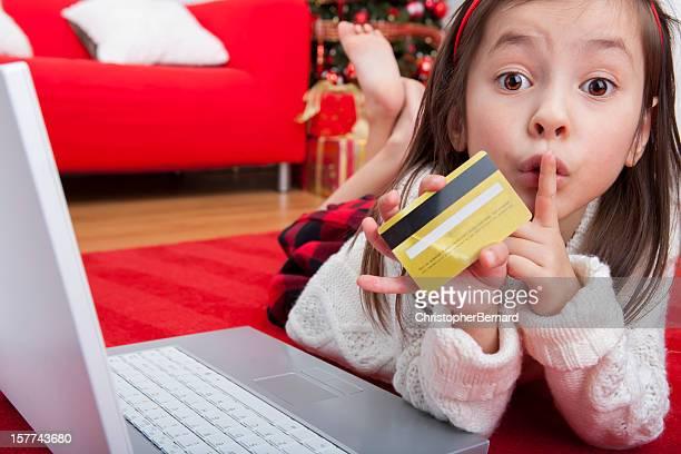 Girl secretly christmas shopping online