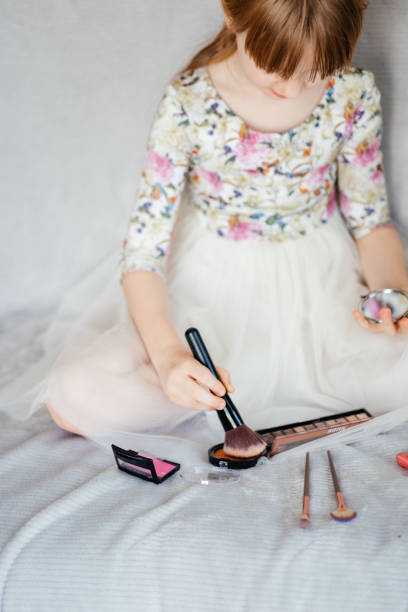 girl secretly does makeup at home