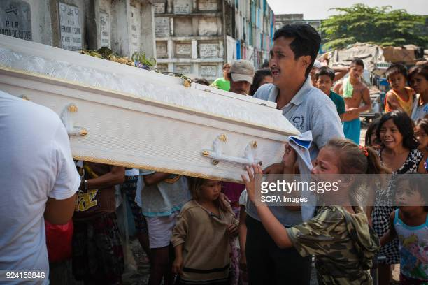 CEMETERY NAVOTAS MANILA PHILIPPINES A girl seen crying as she carries a sarcophagus in the navotas cemetery slum In the center of Pasay District of...