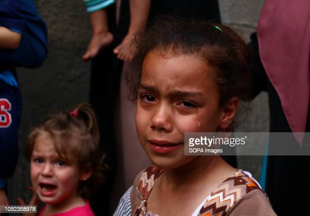 A girl seen crying during the funeral of martyr Naji Jamal alZa'anin Naji Jamal alZa'anin 25 years old was killed by an Israeli airstrike in the Gaza...