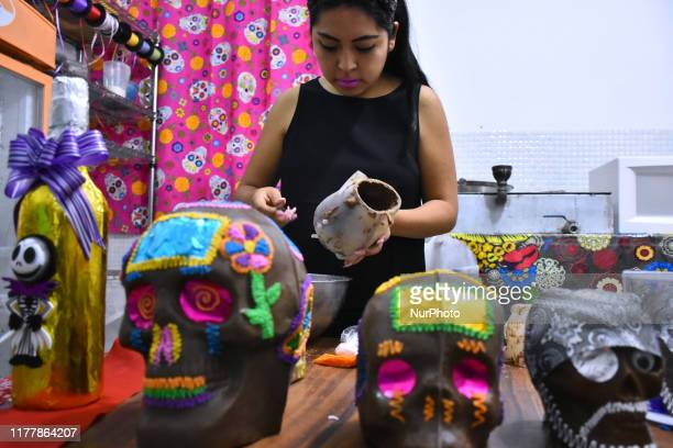 Girl seen manufacturing chocolate skull at chocolate factory on October 23, 2019 in Mexico City, Mexico. Mrs. Judith Morales founded 30 years ago 'La...