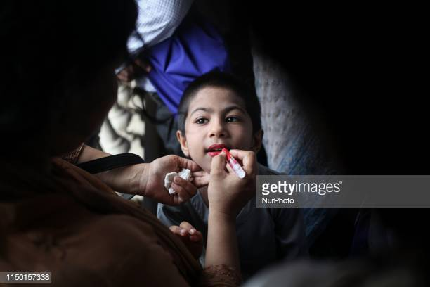 A girl seen preparing before a dance performance Bangladeshi people celebrate first Bengali day of monsoon in Dhaka Bangladesh on Saturday 15 June...