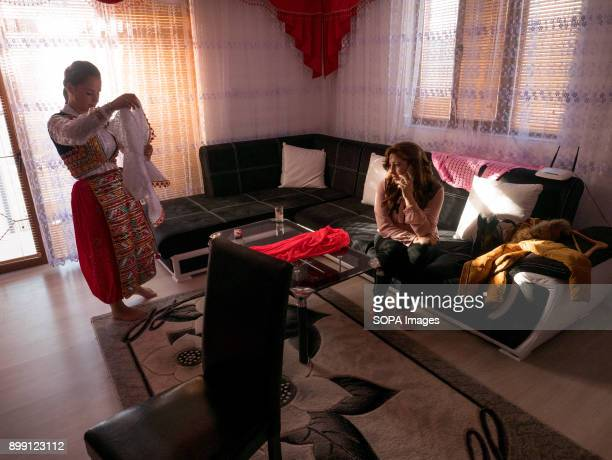 A girl seen preparing to attend the wedding by putting on her traditional clothing Kimike Inuz is 18 years old and today is her wedding She comes...