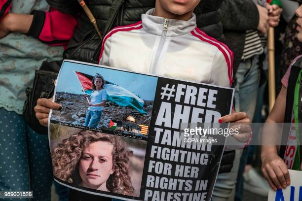 A girl seen showing a sign calling for the freedom of the Palestinian activist Ahed Tamimi Hundreds of people have gathered to commemorate the day of...
