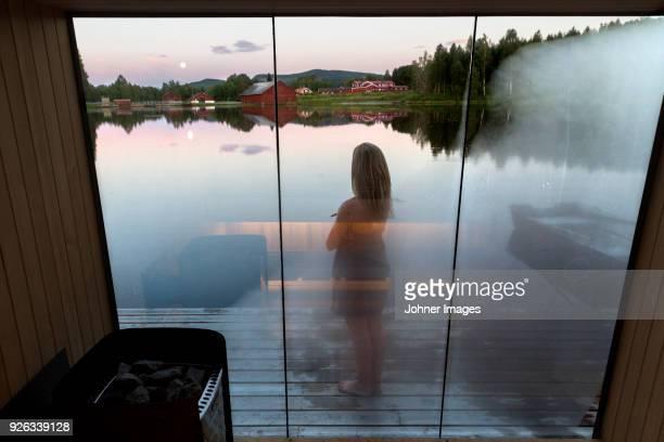 girl seen through steamed glass - sauna stock-fotos und bilder