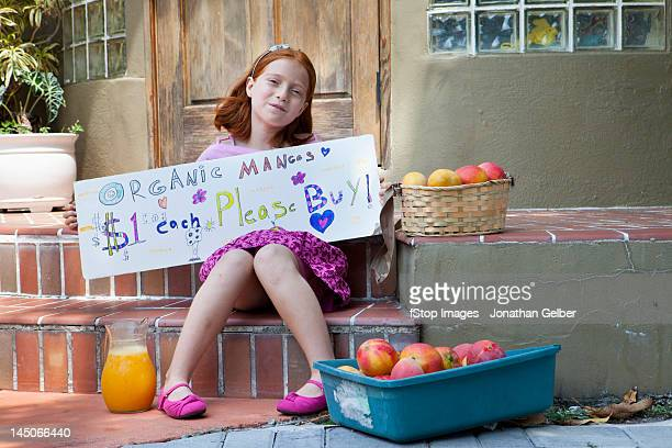 girl selling apples on the front porch - little girls up skirt stock photos and pictures