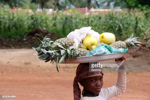 Girl selling fruits on a platter Togo
