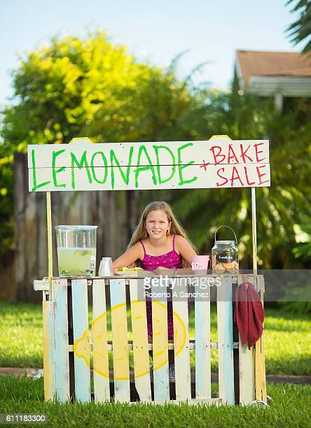 Girl selling lemonade on stand