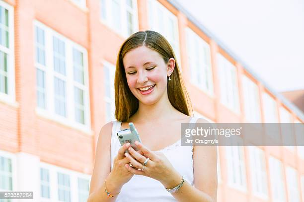 girl sending text message on cell phone - jim craigmyle stock pictures, royalty-free photos & images