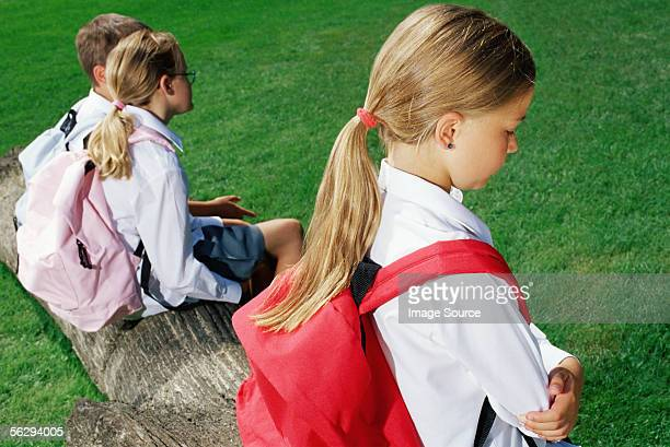 Girl separate from other children