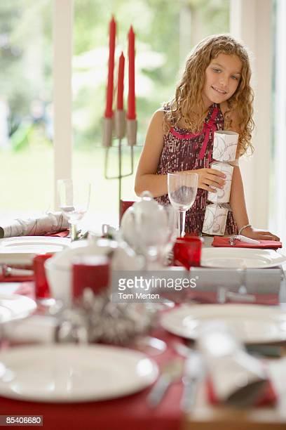 Girl setting Christmas table