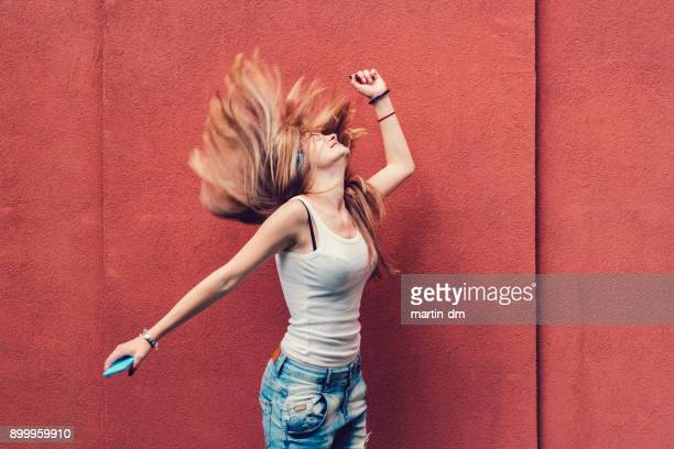 girl shaking head to music - dancing stock pictures, royalty-free photos & images