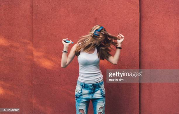 Girl shaking head to the music