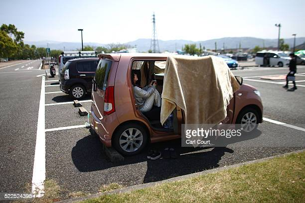 Girl shelters in a car at an evacuation centre following an earthquake, on April 20, 2016 in Mashiki near Kumamoto, Japan. As of April 20, 48 people...
