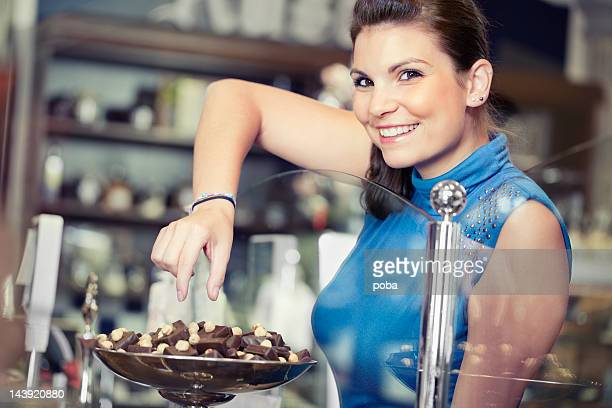 girl shopping and admireing  different chocolate goodies