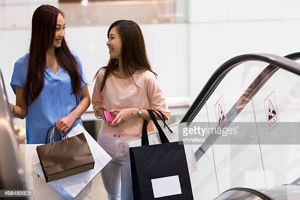 girl shopping at luxury mall - fashion hong kong stock photos and pictures