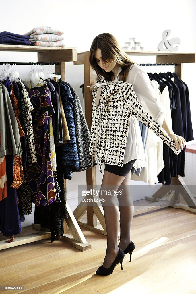 Girl shopping for clothes in a store front. : Stock Photo