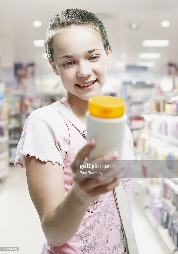 Girl shopping in store : Stock Photo