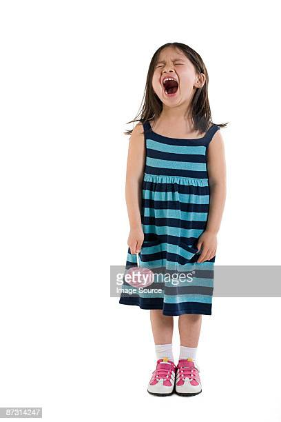 Girl shouting and holding a lollipop