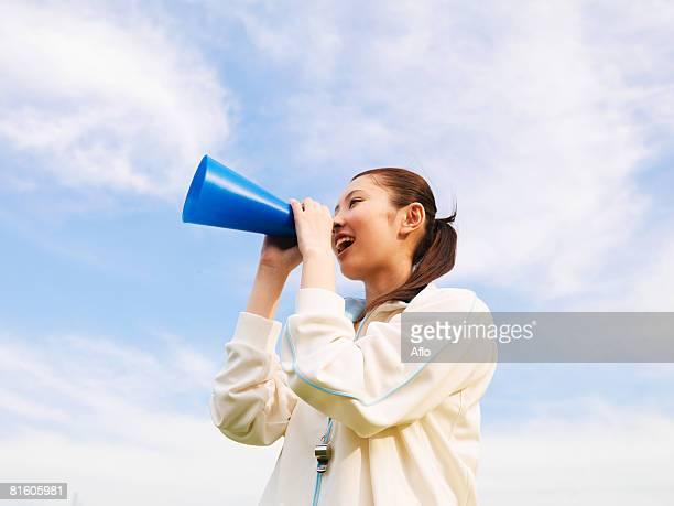 Girl Shouting into Horn
