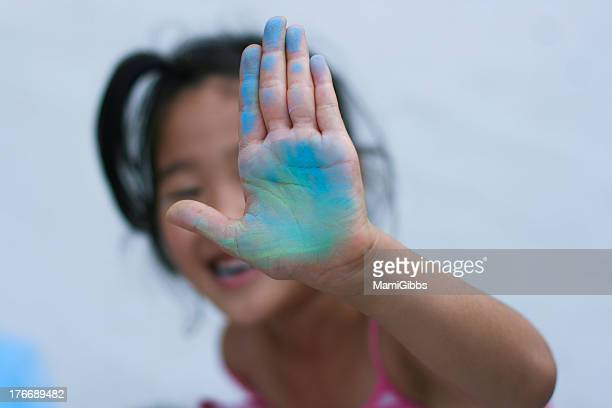 Girl showing colorful left hand