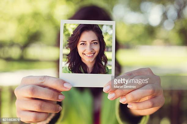 Girl showing instant photo