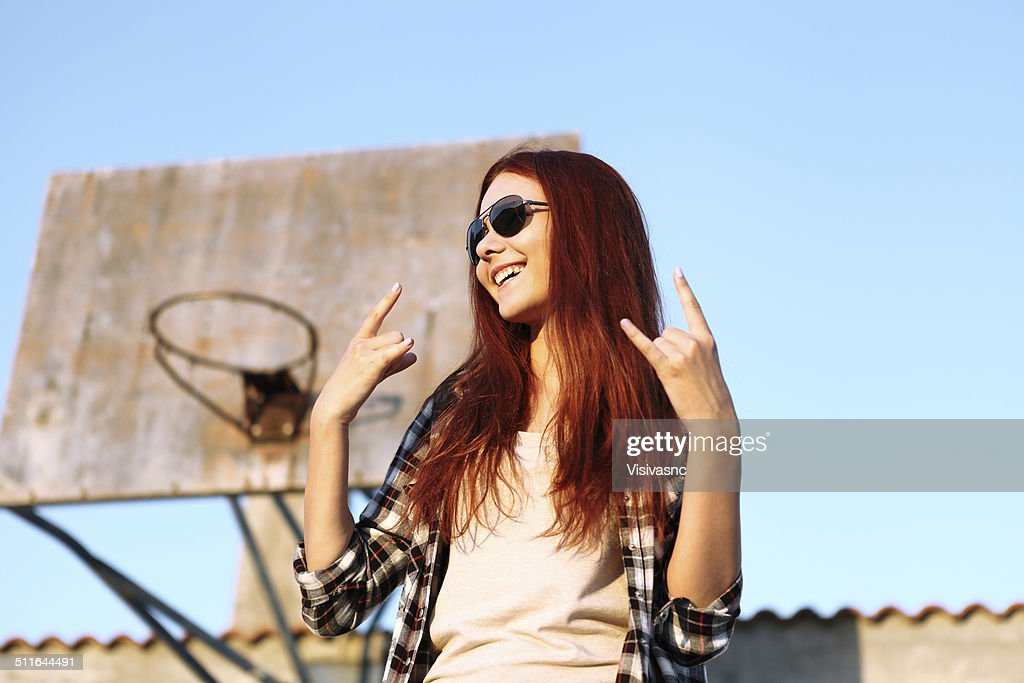 Girl Showing Symbol Of Rock Music Stock Photo Getty Images