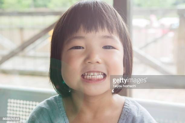 girl showing teeth - japanese girl stock photos and pictures