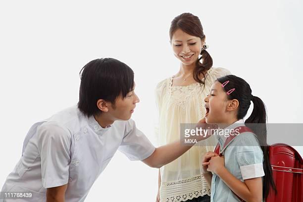 Girl Showing Teeth to Dentist