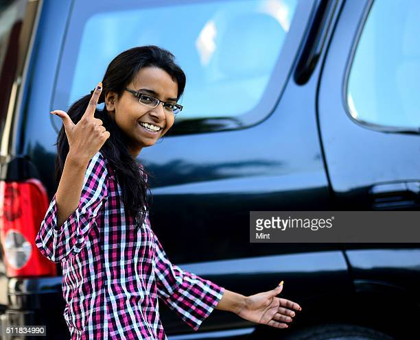 A girl showing the mark after casting her vote first time for general election of the 16th Lok Sabha 2014 on April 10 2014 in New Delhi India