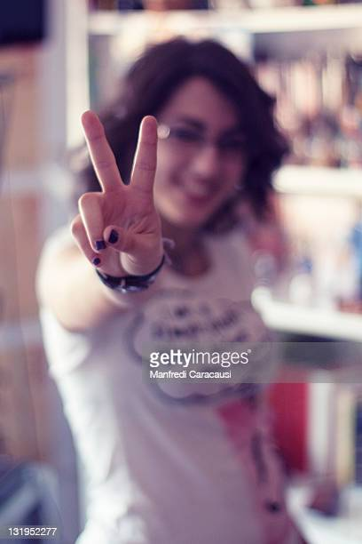 Girl showing victory sign