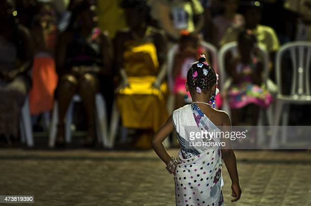 A girl shows an AfroColombian hairstyle during the 11th Afrohairdressers contest Tejiendo Esperanzas on May 17 in Cali Valle del Cauca department...