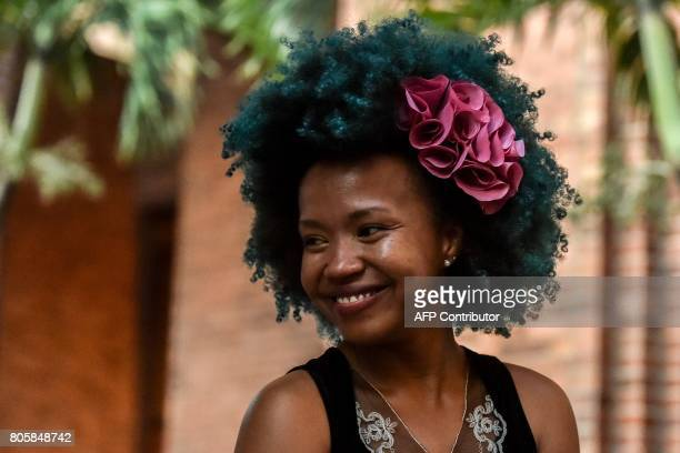 A girl shows an AfroColombian hairstyle during the 13th contest of Afro hairdressers Tejiendo Esperanzas in Cali Valle del Cauca department Colombia...
