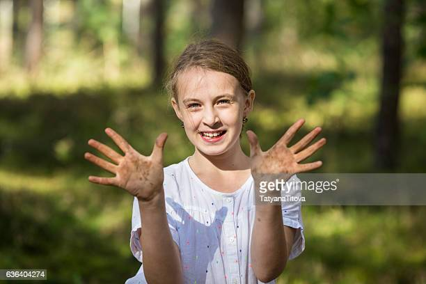 girl shows hands soiled with clay - latvia stock pictures, royalty-free photos & images