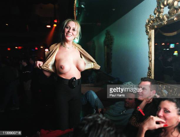 A girl shows her breast at Club Utopia's Nymphomaniac's Ball one of the many adult events held to celebrate The Adult Video Awards January 8 1999 Las...
