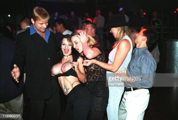 A girl shows her breast at Club Utopia's Nymphomaniac's Ball one of the many adult events held to celebrate The Adult Video Awards January 8 1999Las...