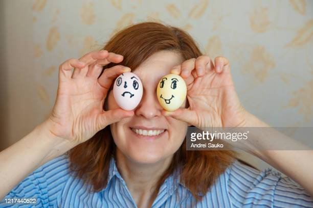 girl shows painted eggs for easter