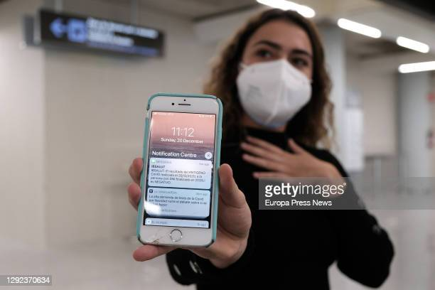 Girl shows the SMS on her mobile phone reporting her negative PCR, at the airport of Palma de Mallorca, on 20 December 2020, in Palma de Mallorca,...
