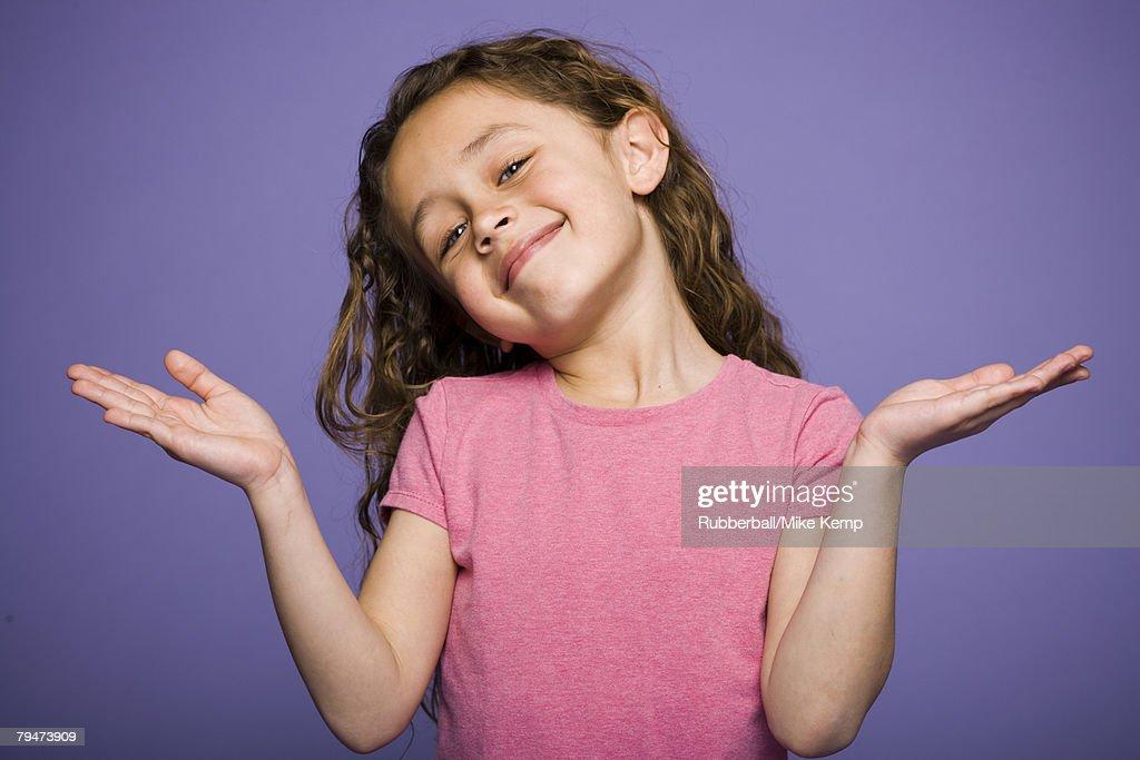 Girl shrugging : Stock Photo