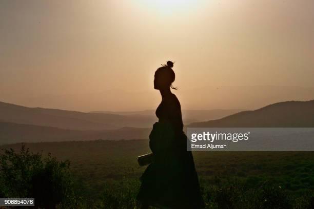 Girl Silhouette in the Ethiopian Rift Valley, Ethiopia - December 12, 2017